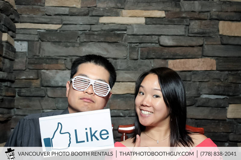 wedding guests having fun in a photobooth
