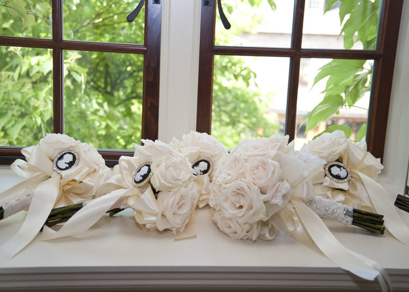 Bridesmaid bouquets with cameo brooches